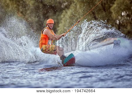 Extreme sport for men water skiing on the board.
