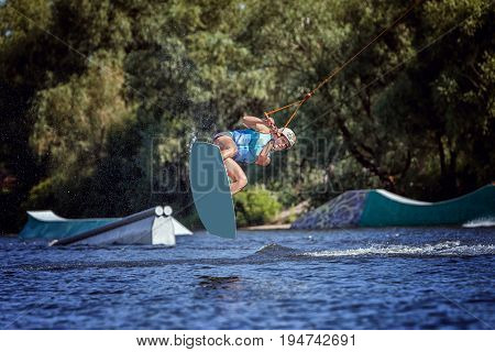 Woman is an extreme sports she trains herself surfing on the lake. Summer sport.