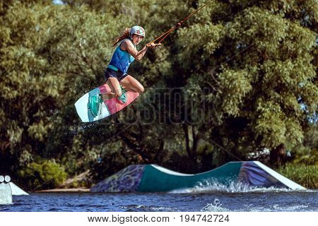 World champion in wakeboarding she trains to jump.
