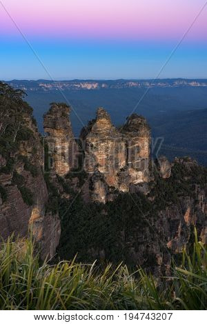 Three Sisters mountains and eucalyptus forest in Blue Mountains National Park on sunset. katoomba NSW Australia