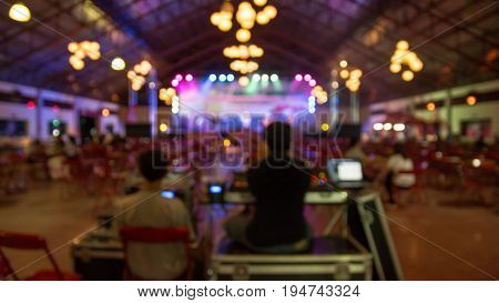 blurred during party or wedding celebration by dj mixer