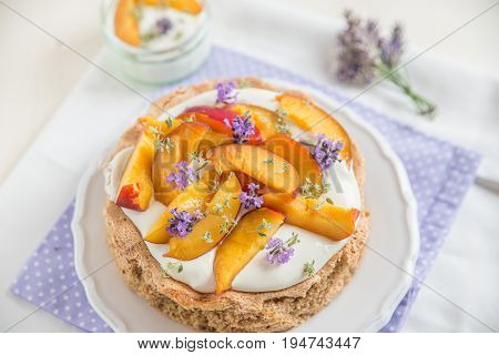 Home made necatrine cake with clotted cream