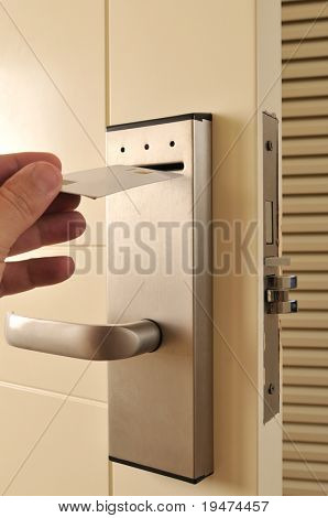 A hand inserting keycard in the electronic lock - a series of HOTEL images.