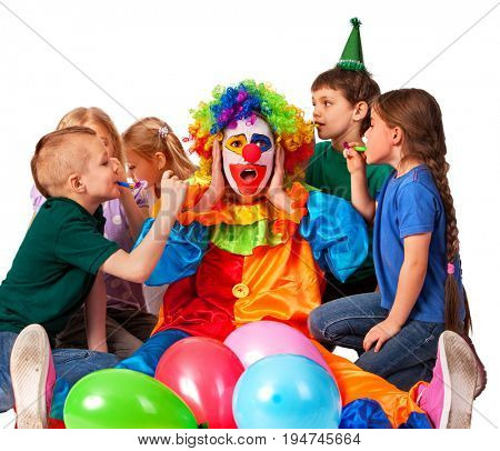 Birthday child clown playing with children and bunny fingers prank. Kid holiday cakes celebratory and balloons happiest birthday. Little ones are very noisy. Holiday for boy and girl in kindergarten.