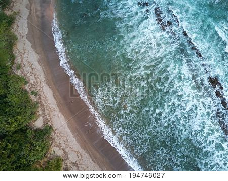 Wild beach on pacific ocean above view from drone in Nicaragua