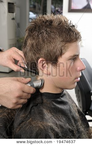 Barber cutting hair with clipper - a series of BARBER images.
