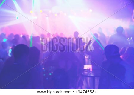 Blur Light In Club Party Show And Silhouette Of Audience Crowd People  Enjoying The Club Party With
