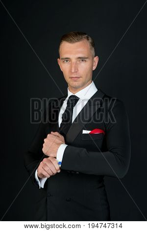 Man In A Black Tuxedo Suit And White Shirt