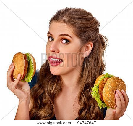 Woman eating hamburger. Student consume fast food on table. Teaches to cook and shares recipes. Girl eats junk alone without embarrassment. Use of semi-finished products.