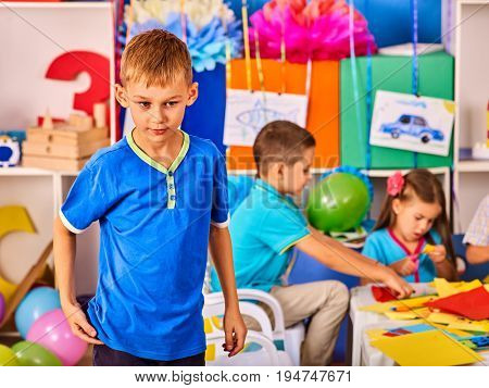 Small students with teacher painting in art school class. Craft drawing education develops creative abilities. Collective creativity in kids club. With boy do not want to play other children. Back to