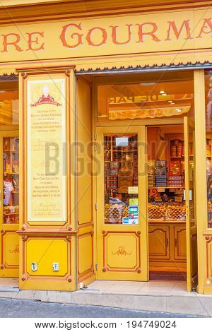 PARIS, FRANCE - JUNE 6, 2012: The colorful entrance to a traditional biscuit candy and chocolate delicatessen in Montmarte in Paris.