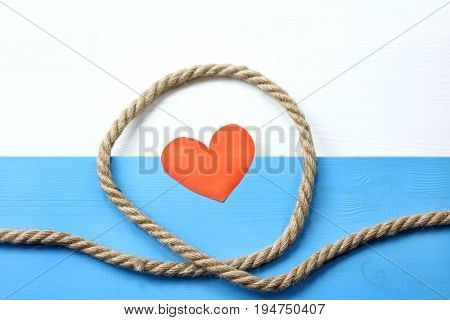 Installation of a thick rope around the symbol of the heart top view / Love loop trap