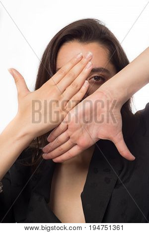 Business Woman Looking Through A Hand Frame Over White