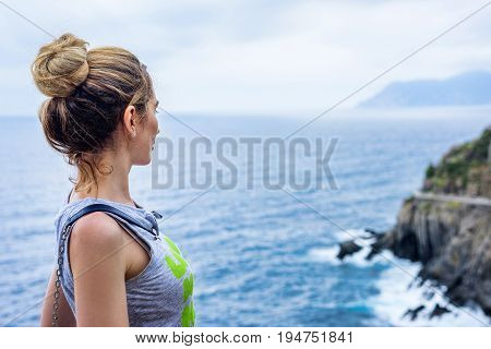 Tourist Girl in Cinque terre Italian riviera. Sea and mountain view. Cinqueterre Liguria beauty