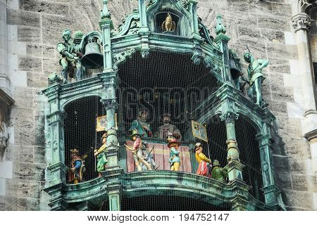 MUNICH GERMANY - MAY 9 2017 : The famous Rathaus Glockenspiel of New Town Hall at Marienplatz in Munich Germany.
