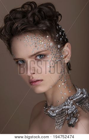 Fashion Young Woman With Romantic Makeup And Beautiful Hairstyle. Shiny Highlighter On Skin. Sexy Gl