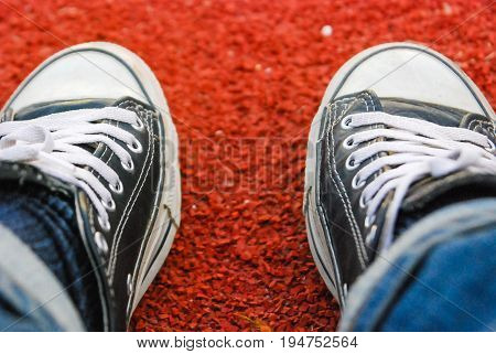 Running track rubber standard red color and shoes