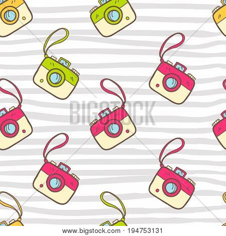 Vector seamless summer pattern with color photo camera. Bright cute cartoon style. Striped background.