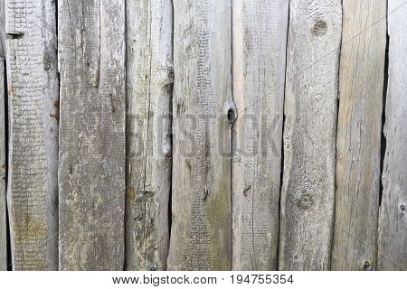 Old ramshackle wooden boards nailed and weather-beaten