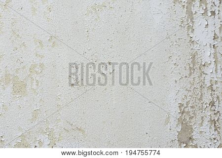 Old cracked paint pattern on wall. Wall covered with cracked paint. Flaking paint on a wall. Scratched old surface