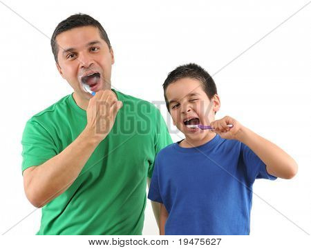 Cute boy and his father brushing teeth isolated on white background - SEE MORE RELATED IMAGES.
