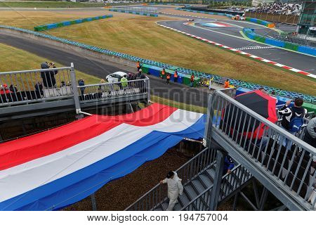Magny-cours, France, July 1, 2017 : French Flag Over The Track. The First French Historic Grand Prix