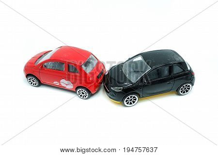 Car Crash Between Red Car And Black Car, Isolated On A White Background