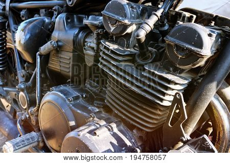 Detail On A Modern And Dirty Motorcycle Engine