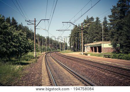 Railroad Tracks Near An Old Small Railroad Station, Transportation Background