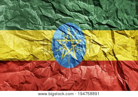 Ethiopia flag painted on crumpled paper background