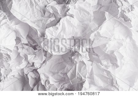 Crumpled wrinkled wavy grey paper texture abstract polygon background.