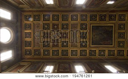 ROME ITALY - JUNE 29 2017: San Lorenzo in Lucina ancient Roman basilica dedicated to St. Lawrence deacon and martyr. Detail of the wooden carved ceiling