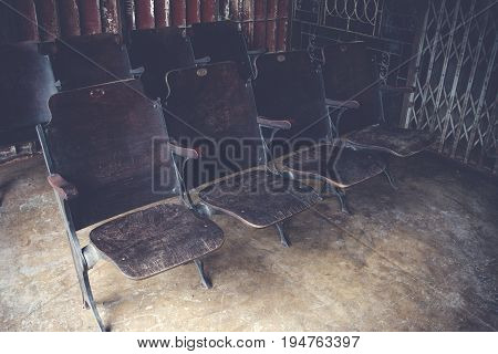 Row Of Vintage Wooden Folding Seating. Armchair Folding Seat In Cinema Be Placed Outside The Vintage