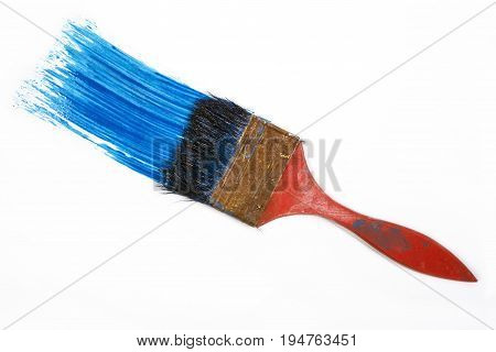 Paintbrush dripping blue paint isolated over white background