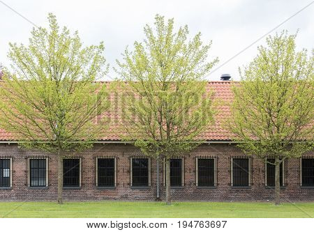 Very old red roof on dutch style house