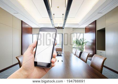 mobile phone in modern meeting room