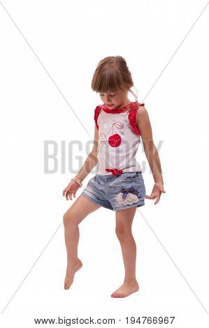 Full length portrait of a happy little girl playing isolated on white background