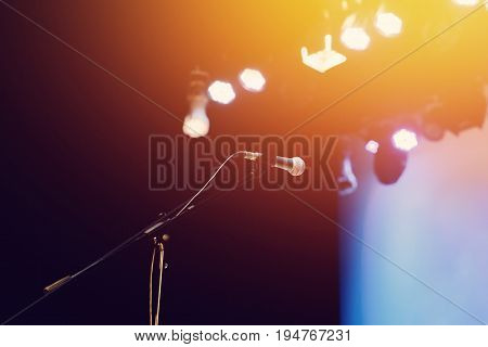 professional microphone on stage in the light of spotlights, Concept karaoke, singer, music.