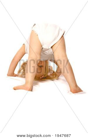 Cute Toddler Girl About To Do A Tumble