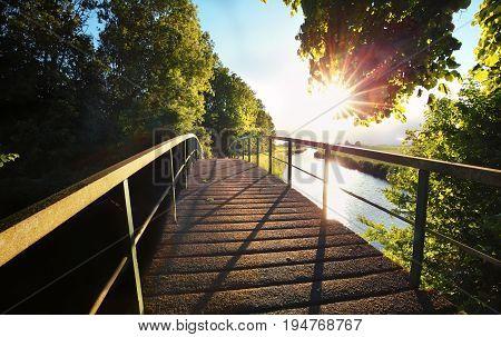 gold sunshine over bridge and river, Netherlands