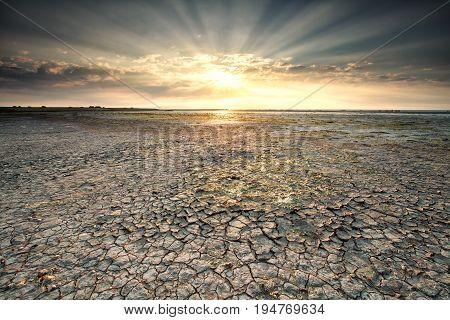 sunbeams over Wadden sea coast Friesland Netherlands