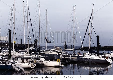 Sailing boats in a harbor in Cuxhaven in the evening