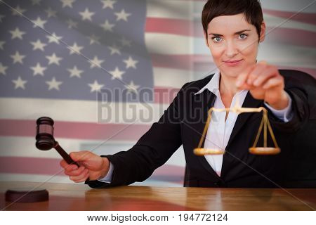 Close-up of American flag against portrait of judge with  gavel and justice scale