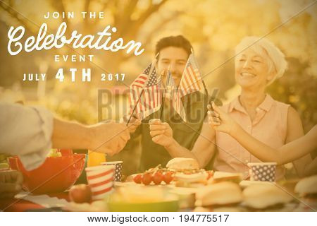 Computer graphic image of independence day message against happy family having a picnic