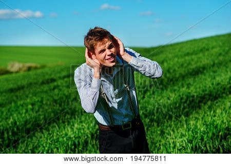 Handsome Man In The Nature Tries To Hear Something With Putting His Hand To His Ears