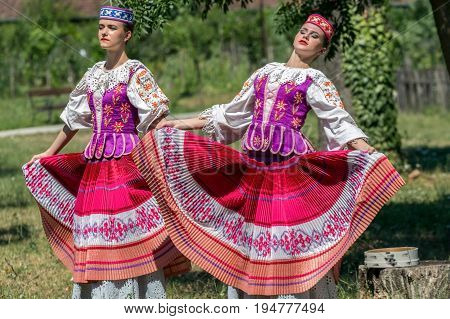 ROMANIA TIMISOARA - JULY 9 2017: Young Belorussian dancers in traditional costume repeat for the show at the international folk festival