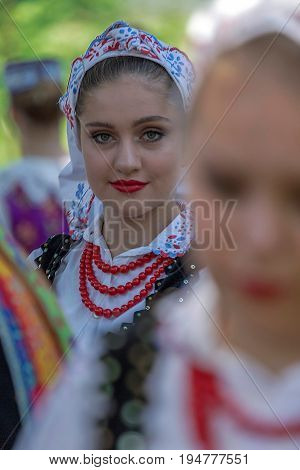 TIMISOARA ROMANIA - JULY 9 2017: Young girl from Poland in traditional costume present at the international folk festival