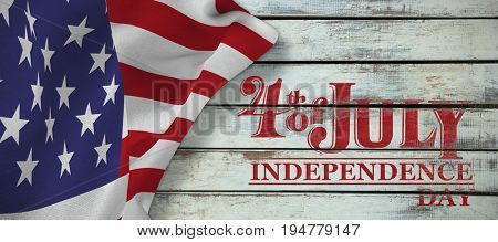 Independence day graphic against wood panels in row