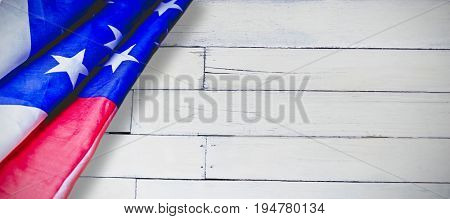 Creased US flag against wood panelling