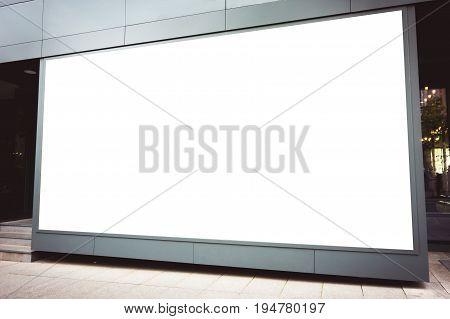 Mock up of store blank street showcase window in a city